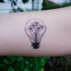 Flower In a Lightbulb Tattoo