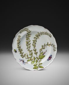 A Chelsea 'Hans Sloane' plate decorated with a botanical plants & insects
