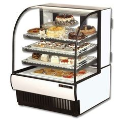 #True White Curved Glass Refrigerated Bakery Case, 19 Cubic FtTrue combines efficient, high volume merchandising with the elegance of this curved glass refrigera...