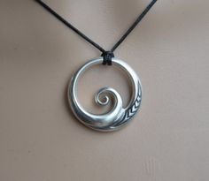 Our original New Zealand koru design in Solid 925 sterling silver. The Maori koru design is a treasured symbol in NZ, it brings renewal & spiritual growth, with inspiration for new ideas & projects and can symbolise a new start in life. As a wave design it brings energy & vitality and connections with the ocean. The engraving shows the NZ fern. These are uniquely New Zealand designs hand made by my partner & I here in NZ. They are fully 3D sculptural pieces & are not holl...
