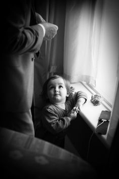 Just love the expression on this little girls face captured looking at grandpa and waiting for mummy to put on her wedding dress...
