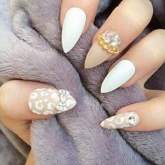 White and neutral stilettos with cheetah print and rhinestones and gold chain.