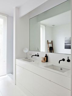 white bathroom with black hardware