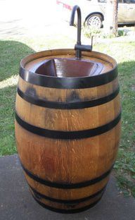Summer, check out the wine barrel sink! Now if we can only get a wine barrel, then Rod can make this for us! Outdoor Projects, Home Projects, Garden Projects, Barrel Sink, Water Barrel, Rain Barrel, Barrel Bar, Barrel Fountain, Bourbon Barrel