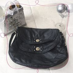 """SALEMarc Jacobs Black Bag Gorgeous Authentic MARC BY MARC Jacobs black bag. 24"""" total drop allows this bag to CONVERT to a large crossbody. 12"""" drop when straps combined. SILVER metal accents. Top notch quality. Double flap over 2 large compartments in the front. 1 open larger compartment in the back and the front compartment has 1 zipper pocket inside and 2 smaller open pockets. Bag is approx 12"""" deep. Slouchy shape. Top and bottom 13-14"""" opening.           WINE AND CHOCOLATE NOT INCLUDED…"""