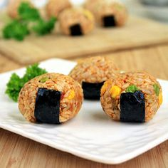 Kimchi Rice Balls (Jumuk Bap) - Perfect as fun appetizers or as a casual meal. Find out the origin and the meaning of these tasty morsels.
