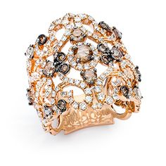 Open lace ring with brown diamonds.