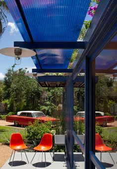 Translucent sunshade.  Orange chairs set off the blue exterior paint.  nice.