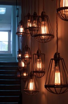 Vintage Cage Pendants hanging in a home in Notting Hill designed by British interior design firm Staffan Tollgård. Industrial Lighting, Vintage Lighting, Home Lighting, Lighting Design, Hallway Lighting, Industrial Chic, Modern Lighting, Cage Pendant Light, Cage Light