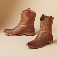 CASSIE SHORT BOOTS--Spirit by Lucchese® sums up the perfect short boot— handmade in soft, supple calfskin in an unusual, versatile maple color, burnished with hand-rubbed wax and side braiding. Leather lining, sole and heel. Imported. Whole and half sizes 6 to 10, 11.View our entire Lucchese Collection