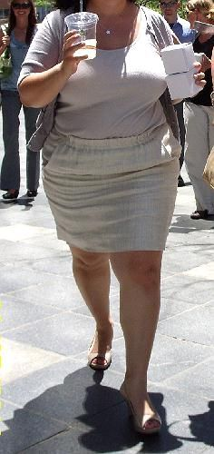 Front shot of the 2nd woman wearing the same wrinkled linen skirt. Her crotch wrinkles are tighter and there are more of them, because her wider hips and thicker thighs pulls the fabric that bunches up in her crotch area when she is sitting tighter and presses more wrinkles into it.