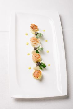Scallops with curry-apple sauce and caulifl ower.  #dolceworld #gastronomy #maincourse