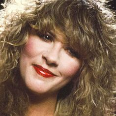 Stevie up close ~ ☆♥❤♥☆ ~ eyes glowing, her lovely face framed by her layered honey blonde locks, and smiling her slightly irregular million dollar smile which is highlighted by bright red lipstick