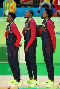 Gold medalists Jimmy Butler Kevin Durant and DeAndre Jordan of the United States…