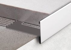 Aluminum edge trim / for tiles Baseboard Trim, Baseboards, Wall Finishes, Floor Finishes, Front Door Entryway, Tile Edge, Master Bathroom Shower, Steel Stairs, Tile Trim