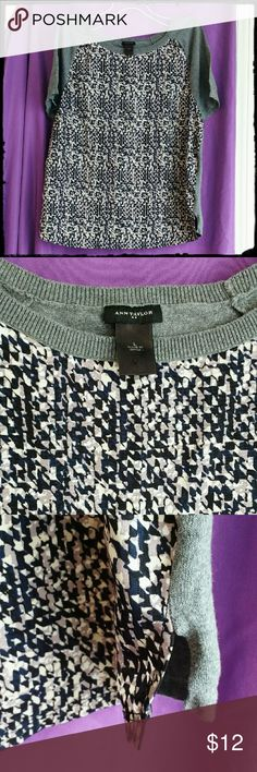 Ann Taylor Sweater Blouse Short sleeve Ann Taylor blouse. Size large. Back and arms are 100% cotton and a light sweater material in gray. Front panel is a polyester blouse material in gray, white, black and navy blue. EUC Ann Taylor Tops Blouses