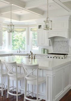 Beautiful all white kitchen with dark wood floor. I love the white island and white bar stools. Beautiful white kitchen for your next kitchen remodel. Kitchen Reno Here We Come. All White Kitchen, Kitchen And Bath, New Kitchen, Kitchen Decor, White Kitchen Stools, Kitchen Layout, Kitchen With Bay Window, White Marble Kitchen, Kitchen Dining