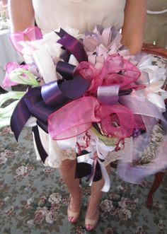 A tutorial on how to easily gather shower gift ribbons to make the rehearsal bouquet.