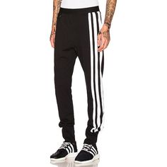 Y-3 Yohji Yamamoto 3 Stripes Pants (850 ILS) ❤ liked on Polyvore featuring men's fashion, men's clothing, men's pants, men's casual pants, pants, mens cotton pants, mens striped pants, mens elastic waistband pants, mens zipper pants and mens stretch waist pants