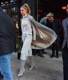 Caped crusader: While Gigi went for a light-coloured look in a pallet of almost entirely g...