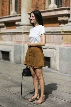 Suede mini skirt with a tee + flat lace-up sandals.