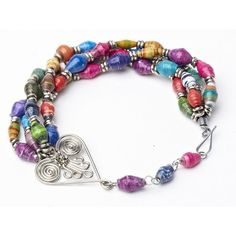 Fair trade - This bracelet showcases paper beads and silver pearls and an intricately hand-fashioned silver wire heart. When you purchase our Healing Hearts fair trade bracelet you help to provide healthcare to the most in need Kenyan children. $14.95 on VavaVida.com