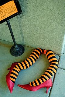 Easy DIY witch legs! I probably have a pair of shoes that could use some glitter and could buy the socks at walmart! So cheap and easy!