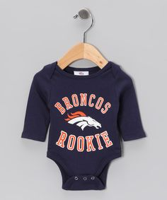 Sports aren't just a hobby—they're a way of life. Football-sized fans will love sporting a favorite team's logo and colors with this cozy, snap-bottom bodysuit.100% cottonMachine wash; tumble dryImported