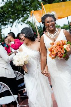 Lovely couple. Lesbian wedding: two white gowns, interracial, poc.