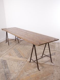 A Plank Top Trestle Table. Simple Pine Top Supported On Wrought Iron  Trestles. English