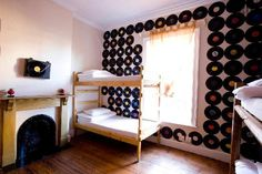33 South Boutique Backpackers Hostel #CapeTown #SouthAfrica This unique hostel in South Africa has an unusual, eclectic look with individually themed rooms, gold-turquoise wallpapers, colourful paint, vinyl record murals and golden accessories. #stylish