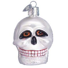 "Skull Christmas Ornament 26021 Merck Family's Old World Christmas Skull ornament measures approximately 2 1/2"", made of mouth blown, hand painted glass. Frightful skull head with"