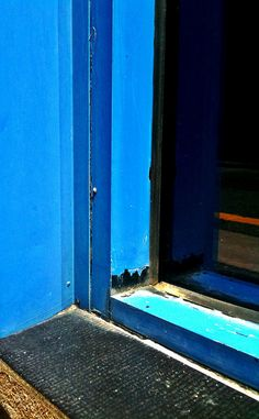 Two colors meet at bottom of door frame.