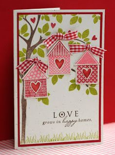 handmade card .... sweet die cut bird houses with heart openings ....hung with gingham ribbon from branches of a stamped tree ... delightful  card !!!