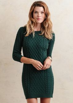 Cozy and chic, this emerald green dress features a semi-fitted silhouette and three-quarter length sleeves. Designed with an eclectic mix of cable knit patterns, this dress is sure to turn h...