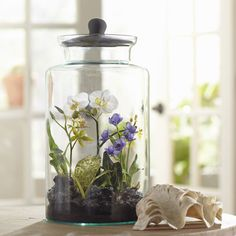 I like the idea of the terrarium. Birch Lane Faux Mixed Orchid Terrarium
