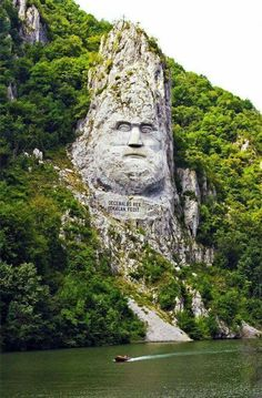 Statue of King Decebalus, Danube River, Serbian/Romanian - the largest rock carving in Europe. Decebalus Orsovo was the last King of Dacia (now Romania). He was defeated by Trajan in 195 A. and his country became part of the Roman Empire. Places To Travel, Places To See, Places Around The World, Around The Worlds, Les Balkans, Hallstatt, Visit Romania, Romania Travel, Neuschwanstein