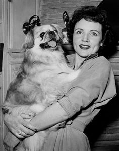 Betty White  and a Pekingese