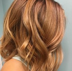 Try a peachy, golden blonde to transition your summer blonde to fall. We love the warm richness of this color by stylist MonicaLynn.