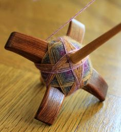 Turkish spindle winding.  I love the way the yarn looks on the spindle and the pull ball you have when you're all done.  awesome!!