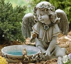 """Sweet Angel Solar Bird Bath Garden Statue. Sweet and peaceful angel for garden, grave or patio. Made of Resin/Stone Mix Measures 10.75""""H 14""""W 9""""D Joseph's Studi"""