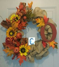 I am absolutely in love with this wreath. My most favorite one I have made. Love the pumpkins, sunflowers and all the leaves.