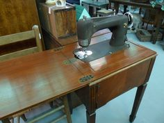 Vintage Montgomery Wards sewing machine with table