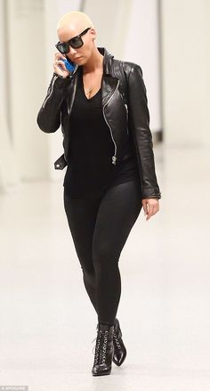 Talking to Kim? Amber Rose was back to business as usual as she touched down in New York later in the day looking sensational in a chic black ensemble