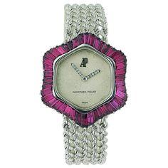 Audemars Piguet, 18k white gold b-wind lady's bracelet wristwatch with 5ct baguette rubies and diamond hands.