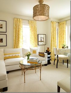 Yellow curtains, neutral walls & furniture.