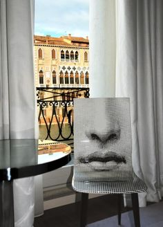 source:Room With a View : Condé Nast Traveler  design:Fornasetti chair  location: Hotel Palazzina Grassi, Venice, Italy