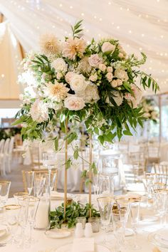 A beautiful September wedding at Castle Hill Inn in Newport RI. We designed theses tall centerpieces with white roses, blush spray roses,snapdragons, greenery and cafe au lait dahlia Tall Flower Centerpieces, Dahlia Centerpiece, Tall Floral Arrangements, Greenery Centerpiece, White Wedding Arrangements, September Wedding Centerpieces, September Wedding Colors, Wedding Table Centerpieces, Blush Wedding Flowers