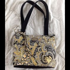 Donna Sharp handbag.  Yellow Cute quilted bag with yellow and black pattern.    Lined with black fabric with 1 pocket inside.  Zipper closure.  Large zippered compartment on back. Donna sharp Bags Shoulder Bags