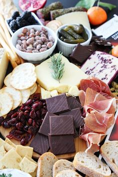 Cheese and Chocolate Board Recipe on twopeasandtheirpod.com This simple cheese and chocolate board is perfect for any party!